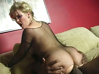 Sex crazed golden-haired in crotchless bodystocking takes on a huge dark meat