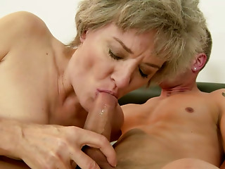 Elder woman with large titties gives her paramour an awesome oral-service