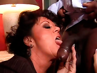 Spoiled dark brown mamma gives a head to strain darksome schlong of hotel waiter
