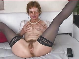 Mature woman with bushy wet crack